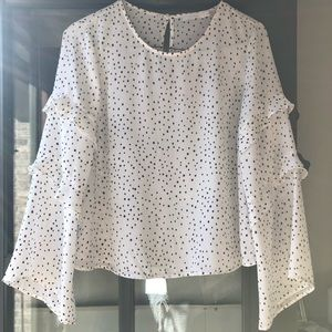 Lush polka dot blouse with ruffle detail on sleeve